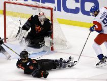 North America's Aaron Ekblad (5) blocks a shot by Czech Republic's Jakub Voracek (93) in front of North America's goalie Connor Hellebuyck (37) during the third period of a World Cup of Hockey exhibition game Wednesday, Sept. 14, 2016. The Czech Republic