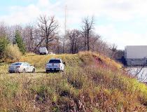 RCMP were still at the scene Oct. 23, along the Red River, near the junction of PRs 204 and 212, where human remains were discovered the day before. Mounties brought in the Manitoba Historical Resources Branch to assist with the investigation. (Glen Halli