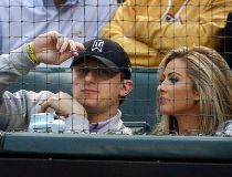 In this April 14, 2015, file photo, Cleveland Browns quarterback Johnny Manziel, left, sits with Colleen Crowley during a baseball game between the Los Angeles Angels and the Texas Rangers in Arlington, Texas. Prosecutors say they have an agreement with J