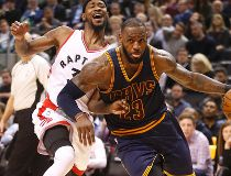 Cleveland's LeBron James blows past Terrence Ross as the Toronto Raptors lost 116-112 to the Cleveland Cavaliers in Toronto, Ont. on Monday December 5, 2016. Michael Peake/Toronto Sun/Postmedia Network