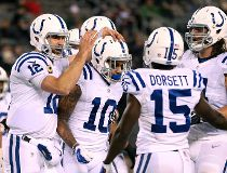 Indianapolis Colts quarterback Andrew Luck, left, celebrates with wide receiver Donte Moncrief (10) after the two connected for a touchdown pass during the second half of an NFL football game against the New York Jets, Monday, Dec. 5, 2016, in East Ruther