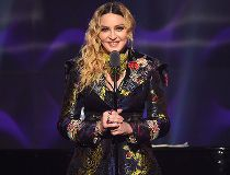 Madonna speaks on stage at the Billboard Women in Music 2016