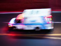 An ambulance speeds off to an emergency.