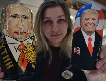 An employee displays traditional Russian wooden nesting dolls, Matryoshka dolls, depicting US President-elect Donald Trump (R) and Russian President Vladimir Putin at a gift shop in central Moscow on January 16, 2017, four days ahead of Trump's inaugurati