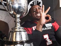 Ottawa Redblacks quarterback Henry Burris (1) and 10-year-old son, Armand, celebrate the Redblacks Grey Cup win over the Calgary Stampeders in Toronto on Sunday, November 27, 2016. Veteran CFL quarterback Burris is retiring. THE CANADIAN PRESS/Frank Gunn