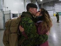 Families reunite with 100 soldiers returning from Poland deployment