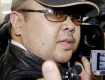 This file photo taken on February 11, 2007 shows a man believed to be then-North Korean leader Kim Jong-Il eldest son, Kim Jong-Nam, surrounded by journalists upon his arrival at Beijing's capital airport.  AFP PHOTO