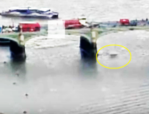 Video shows a woman plunging into the River Thames during Wednesday's London terror attack.