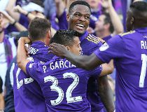 Cyle Larin #9 of Orlando City SC celebrates his goal with Matias Perez Garcia #32 and Carlos Rivas #11 and Antonio Nocerino #23 of Orlando City SC during a MLS soccer match between New York City FC and Orlando City SC at the Orlando City Stadium on March