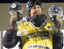 Mark McMorris of Regina, Sask., raises his Crystal Globes at the FIS Snowboard World Cup Big Air event in downtown Quebec City on February 11, 2017. Canadian snowboarding star Mark McMorris is in a Vancouver hospital after suffering several injuries in a