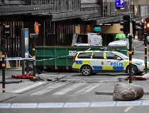 A concrete traffic stopper (down-R) lies on its flank on April 8, 2017, at the scene where a truck crashed into the Ahlens department store at Drottninggatan in central Stockholm / AFP PHOTO / TT NEWS AGENCY / Jonas EKSTROMER / Sweden OUTJONAS EKSTROMER/A