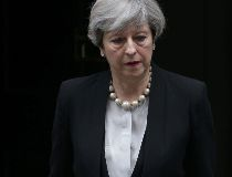 Britain's Prime Minister Theresa May leaves after delivering a statement at 10 Downing Street in central London on May 23, 2017 after an emergency meeting of the Cobra committee in response to a deadly suspected suicide bombing in the northern city of Ma