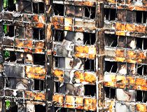 The charred remains of clading are pictured on the outer walls of the burnt out shell of the Grenfell Tower block in north Kensington, west London on June 22, 2017. AFP PHOTO / NIKLAS HALLE'NNIKLAS HALLE'N/AFP/Getty Images  BRITAIN-FIRE