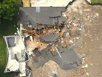 Sinkhole swallows two homes in Florida_7