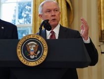 In this Feb. 9, 2017, file photo, President Donald Trump listens as Attorney General Jeff Sessions speaks in the Oval Office of the White House in Washington, after Vice President Mike Pence administered the oath of office to Sessions.