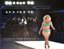 A model walks the runway during Sports Illustrated and Wall