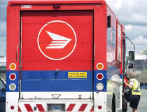 A cyclist's-eye view of a Canada Post truck