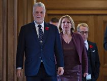 Quebec Premier Philippe Couillard, left, and Christine St-Pierre,