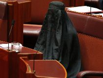 Senator Pauline Hanson wears a burqa during question time in the Senate chamber at Parliament House in Canberra, Australia, Thursday, Aug. 17, 2017. Hanson, leader of the anti-Muslim, anti-immigration One Nation minor party, sat wearing the black head-to-
