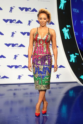 Mel B takes aim at estranged husband with 'You will never own me' dress