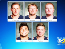 Five Wheaton football players are wanted for allegedly hazing a teammate.