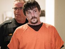 In this April 25, 2017, file photo, Joseph Jakubowski is escorted into a room at the Rock County Courthouse for his preliminary hearing in Janesville, Wis. Jakubowski, who is accused of stealing an arsenal of firearms from a southern Wisconsin gun shop an