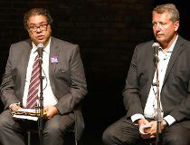 Calgary Mayor Naheed Nenshi between candidates David Lapp and Bill Smith
