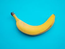 banana on blue pastel background. minimal concept. flat lay.