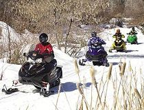 Sledders enjoying the well-maintained trails that the Ontario Federation of Snowmobile Clubs offers. (Courtesy Ontario Federation of Snowmobile Clubs)