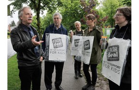 B.C. Teachers Federation president Jim Iker (left) speaks to teachers during a work stoppage by teachers outside Charles Dickens Elementary in Vancouver on May 26, 2014.