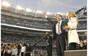"While tens of millions of people seeking success and wealth put their faith in televangelist Joel Osteen, critics charge his message has little to do with Jesus, who taught, ""You cannot serve both God and mammon."" (Photo: Joel Osteen and Victoria at Yankee Stadium.)"