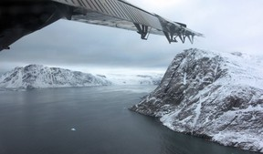 A look at the entrance to Grise Fiord, Nunavut from under the plane wing.