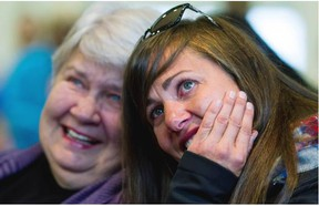 Canadian Olympic gold medalist Maelle Ricker (right) and her mother Nancy Ricker react while watching a video tribute to Maelle's career after she announced her retirement from competitive snowboarding during a press conference in North Vancouver on Wednesday, Nov. 4, 2015.