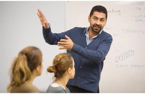 Masud Azar, a family and youth outreach worker, teaches a class to refugees at SUCCESS,  Vancouver November 27 2015.