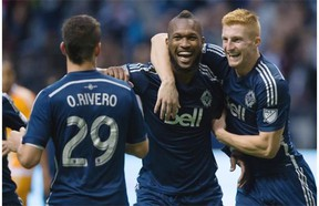 Vancouver Whitecaps' Kendall Waston, centre, celebrates his goal with teammates Tim Parker, right, and Octavio Rivero. Waston was named the BMO Player of the Year in a fan vote earlier in the day.