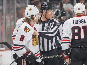ST. PAUL, MN - MARCH 29: Duncan Keith #2 of the Chicago Blackhawks is escorted off the ice after being given a match penalty against the Minnesota Wild during the game on March 29, 2016 at the Xcel Energy Center in St. Paul, Minnesota.