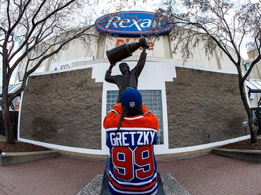 EDMONTON, AB - APRIL 6:  Fans take photos of the Wayne Gretzky statue outside of Rexall Place prior to the game between the Edmonton Oilers and the Vancouver Canucks on April 6, 2016 in Edmonton, Alberta, Canada. The game is the final game the Oilers will play at Rexall Place before moving to Rogers Place next season. (Photo by Codie McLachlan/Getty Images)
