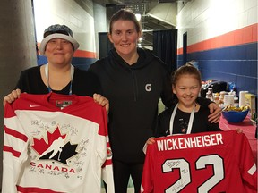 Emily Gordon poses for a photo with her mom, Sheryl Sadorski, and Team Canada's Hayley Wickenheiser at the women's world hockey championships in Kamloops. — Hockey Canada ORG