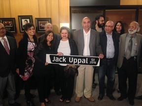 Friends and family members of Jack Uppal with the Vancouver street named in his honour.