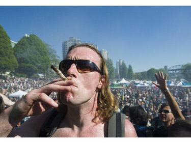 People light up at the annual 4:20 marijuana event at it's new location at Sunset Beach, Vancouver April 20 2016.