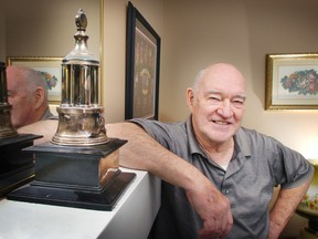 Charlie Hodge poses with one of the two Vezina Trophies he won as a member of the Montreal Canadiens in the 1960s at his home in 2007. Hodge died on April 15, 2016 at the age of 82.