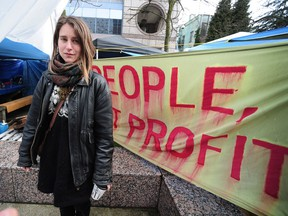 Protester Kristin Henry was hospitalized after a hunger strike but is recovering and visited the downtown Vancouver protest site on Sunday.