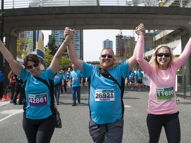 VANCOUVER,BC:APRIL 17, 2016 -- Runners celebrate after crossing the finish line of the 2016 Vancouver Sun Run in Vancouver, BC, April, 17, 2016. (Richard Lam/PNG) (For ) 00042786A [PNG Merlin Archive]