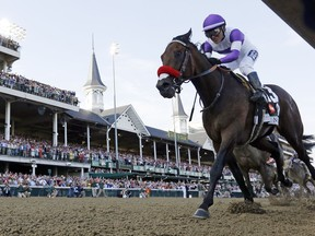 Jockey Mario Gutierrez rides Nyquist to victory at the Kentucky Derby at Churchill Downs in Louisville, Ky., on Saturday, May 7, 2016.