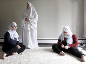Syrian refugees Hoda (l) and Maha Al-Sidawi with their mother Fayza Al-Sidawi, in Burnaby, BC., June 20, 2016. The sisters are disabled and it has been difficult to access the medical system without a family doctor.