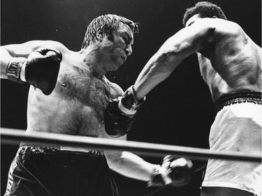 FILE PHOTO - Muhammad Ali pounds George Chuvalo during a fight on May 1, 1972 at the Pacific Coliseum