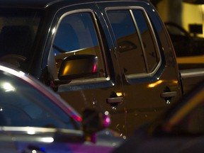 Bullet holes can be seen on the driver side door of a Nissan truck after a man was shot at Coppersmith Plaza in Richmond on June, 4, 2016.