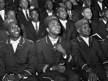 ADVANCE FOR USE SUNDAY, FEB. 23, 2014 AND THEREAFTER - FILE - In this Feb. 28, 1966 file photo, Muhammad Ali listens to Elijah Muhammad as he speaks to other black Muslims in Chicago. (AP Photo/Paul Cannon) ORG XMIT: NY354