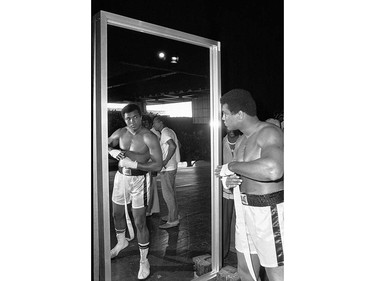 ADVANCE FOR USE SUNDAY, FEB. 23, 2014 AND THEREAFTER - FILE - In this Sept. 29, 1975 file photo, Muhammad Ali, world heavyweight boxing champion, looks at himself in a mirror during a training session in Manila, Philippines before his Oct. 1 fight against Joe Frazier. (AP Photo) ORG XMIT: POS2016060317075553      Muhammad Ali options ORG XMIT: POS1606031709490336