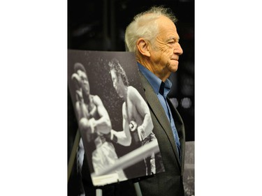 Former Vancouver Sun Ralph Bower poses November 10, 2011 with a photograph of Muhammad Ali and George Chuvalo made at the Pacific Coliseum in Vancouver, B.C. in 1972.
